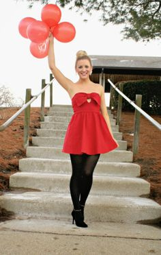The Daily Sugar in a Deb Shops red dress