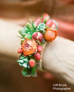 Corsage...love this! Tiny roses and succulents!!!!!