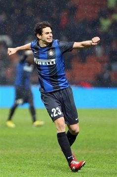 Inter Milan defender Andrea Ranocchia celebrates after scoring his side's third goal during the Italian Cup quarter final soccer match between Inter Milan and Bologna, at the San Siro stadium in Milan, Italy, Tuesday, Jan. 15, 2012. Inter Milan won 3-2 and advances to the semifinals. (AP Photo/Luca Bruno)