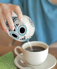 Fred & Friends Sugar Skull Porcelain Sugar Shaker   Inspired by the brilliant colors and symbols of Mexico's Day of the Dead, this porcelain sugar skull shaker will add some life to your dining festivities.