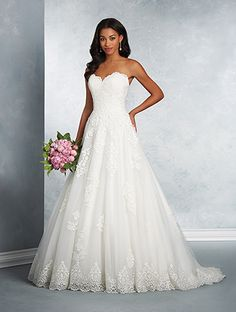 A beautiful lace wedding dress with a strapless, sweetheart neckline, natural waist, A-line skirt, and chapel train