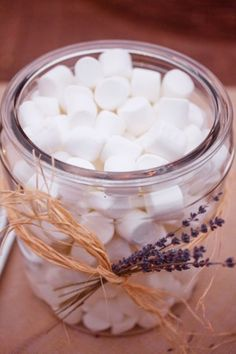 Cute idea for hot cocoa or Smores bar at a winter party! Fill mason jars with all the goodies...load your mugs & Mmmmmm.  Would be cute with cinnamon sticks for cider!