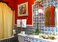 Blue and white tiled bathroom with red walls and yellow shower curtain