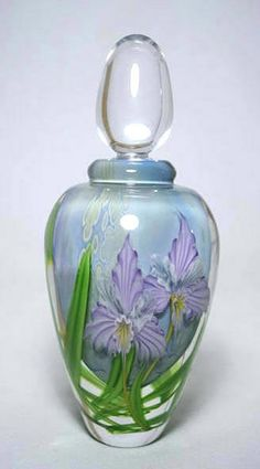 GlassMaster Mayauel Ward's Tropic Orchid Perfume Bottle, an exquisite multi-layered creation of pretty orchids housed in clear glass set against a sky blue background. Green vines add color and brings this flower to life.