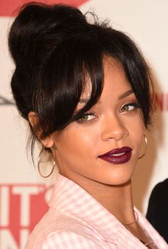 Singer Rihanna made a surprisingly subtle red carpet appearance with a high bun and soft parted bangs. But just because she rocked a sweet hairstyle doesn't mean she didn't go bold her with makeup. We expect nothing less from the beauty chameleon.