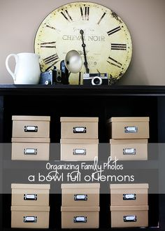 Memory Keeping & Photo Organization in less than 10 minutes per year! via A Bowl Full of Lemons. *i am looking for these boxes to do this look.its so ligical!