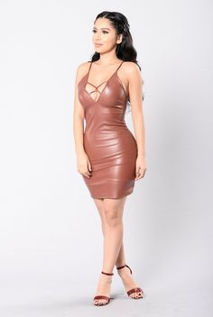 - Available in Black and Red/Brown - Spaghetti Straps - Tight Fit - Criss Cross Detail - 50% PU 35% Polyester 15% Cotton