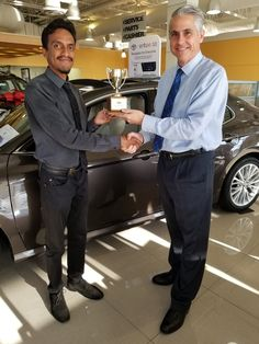My colleague Saeed gets Salesperson of the Month award from Chris Kronzer, gen. sales mgr. @ Koons Arlington Toyota. @koonsauto @Toyota