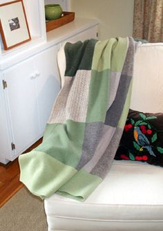 """Green Sweater Blanket. Brrrrrrrrr, it's getting cold! Time to bring out the wool blankets. My favorite one is made from reclaimed sweaters. I felted wool sweaters and part of an old wool blanket to make this 60"""" x 80"""" patchwork throw. It's soft, warm and oh so green. Here's how to make it."""