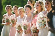 LOVE the bridesmaids' bouquets. Simple but more than just baby's breath :)