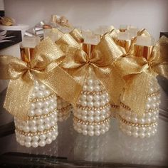 gold 'n pearls with gold ribbon. Wine Bottle Art, Wine Bottle Crafts, Jar Crafts, Diy And Crafts, Arts And Crafts, Diy Y Manualidades, Altered Bottles, Bottles And Jars, Wedding Centerpieces
