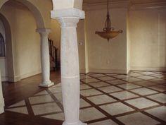 Carpet inlay wood floor bordering 3 feet around room wall for High traffic flooring ideas