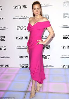 Pretty in pink: Amy looked magical in a magenta dress for the Vanity Fair party in Los Angeles in February