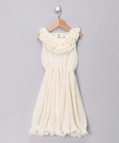 Take a look at this Cream Ruffle Dress -PERFECT FOR SPRING PICTURES