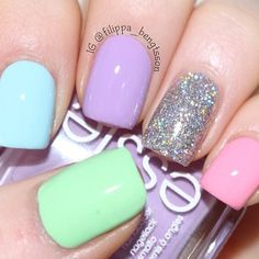 We love these pastel spring nails! How amazing is the sparkle too? | Get this look at Capricio Salon and Spa Milwaukee, WI www.capriciosalon.com