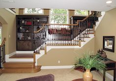 love the atrium staircase with bookshelves!