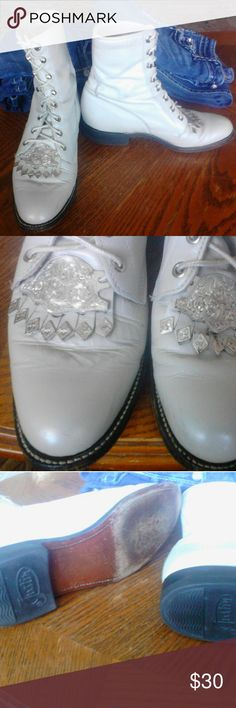 Justin lace-up Roper  boot silver shoe jewelry Gorgeous round toe white Justin Ropers in decent shape These Boots tied up or lace up and having Medallion or jewelry the boots are in good condition please see pictures there is one where mark on the heel this could be covered over with polish. Otherwise in good condition Justin Boots Shoes Heeled Boots