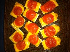 EASY Snack for Super Bowl    Crackers, Slice of Cheddar Cheese & Pepperoni microwaved for 45 seconds... SO GOOD :)