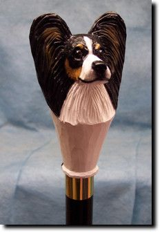 Papillon Dog Walking Stick Our unique selection of handpainted Dog Breed Walking Sticks is sure to please the most discriminating Dog Lover! Be the envy of everyone with this unique canine walking sti