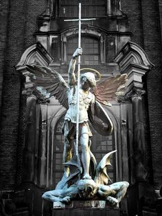 Sculpture of the archangel Michael defeating Satan, St Michael's Church, Hamburg, Germany Angels Among Us, Angels And Demons, Statue Ange, St. Michael, Michael Angel, Michael Wolf, Cemetery Art, Cemetery Statues, Art Sculpture
