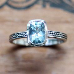 Aquamarine cushion ring with wheat braid band. March birthstone! By Metalicious, $260.00