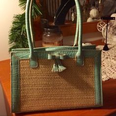 Lovely Liz Claiborne Purse, Teal Blue and tan Lovely Liz Claiborne Purse .  Teal Blue faux croc or alligator with straw accent.  6 inches high by 3 inches deep by 9 1/2 inches long.  Handles drop 6 1/2 inches.  Snap closure.  Has one small mark inside (see picture ) Liz Claiborne Bags