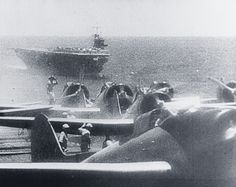 "80-G-182252: Pearl Harbor Attack, 7 December 1941. A Japanese Navy ""Zero""…"
