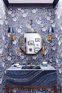 Summer style!! Blue and white powder room! LOOK at the fabulous sink! Peony wallpaper lines the walls of this color-happy powder room. | archdigest.com