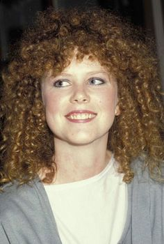 Kidman before the Hollywood makeover. // Wow. Completely different person.