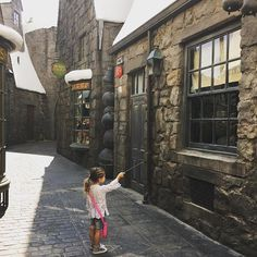 Living the enchanted life! Kourtney Kardashian shared an adorable photo of her daughter, Penelope, trying her hand at some muggle magic at Universal Studios.
