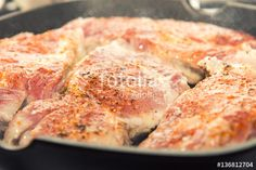 "Download the royalty-free photo ""Fresh pork steak with spices cooking on teflon pan grill. Shallow depth of field."" created by Victoria Kondysenko at the lowest price on Fotolia.com. Browse our cheap image bank online to find the perfect stock photo for your marketing projects!"