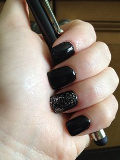 Black nails with sparkly accent nail. Would look good w/ a deep green or navy