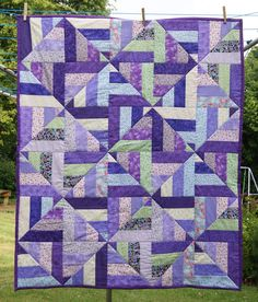 """My take on a scrap strip quilt which is also on this page called """"strip twist""""! I did this in floral purples and pastels. I like the illusion that its diamonds on point - it isn't. Quick to make."""