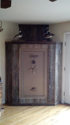 A very simple diy reclaimed barn wood beam cover cover for Bedroom furniture gun safe