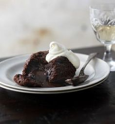 We show you how to make the ultimate gooey-centred chocolate puddings. Serve with softly whipped cream or a scoop of ice cream