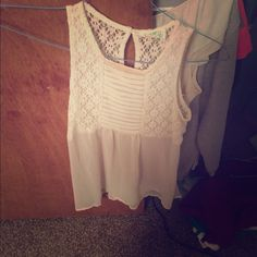 White sleeveless dream out loud top Very cute but has a makeup stain on collar Tops Blouses