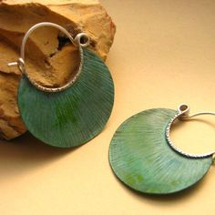 Verdigris hoop earrings by Mocahete.