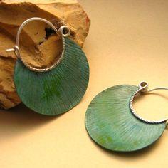 Verdigris hoop earrings by Mocahete.