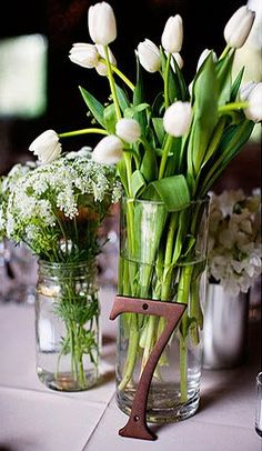 Awesome inexpensive table numbers and flowers!