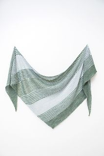 Sea Grass is large and lofty wrap with bias construction, knit in two colors of fingering weight yarn.