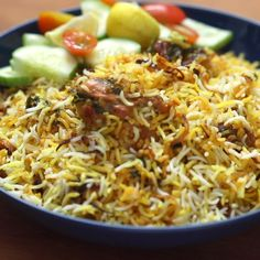 Serves 5 · Make this restaurant style biryani at home! Succulent, juicy pieces of chicken are cooked in a yogurt marinade and then layered with crispy onions, coriander, mint and basmati rice to give you a dish that the entire family will enjoy. Slow Cooker Sausage Recipes, Vegetarian Recipes, Healthy Recipes, Indian Food Recipes Easy, Mexican Rice Recipes, Indian Dessert Recipes, Halal Recipes, Cooking Recipes, Indian Recipes