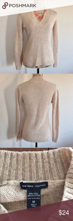 """NY & Co V neck sweater V neck sweater from New York & Co is a tan oatmeal marled knit. Wool blend so it's warm but not heavy or bulky. Perfect for spring as well. Size M. Excellent condition. Length 24"""", bust 18 1/2"""". ⭐️ New York & Company Sweaters V-Necks"""