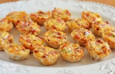 Cheesy Bacon Rotel Cups: a combination of cheese, bacon and Rotel (canned chopped tomatoes and green chilies) stuffed inside a tiny pastry cup then baked into perfection.