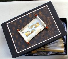 handmade card ... black bakgrounds ... small gold water lilies on top layer ... faux scroll opens to koi and Asian calligraphy ...  great card! ... Crafter's Companion ... A Little Bit Oriental Collection ...