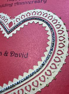 A henna tattoo inspired card for and Indian couple celebrating their 10th wedding anniversary.  A bespoke request using paper cuts in gold with additional golden glitter embellishment placed on a stunning deep red pearlescent card.