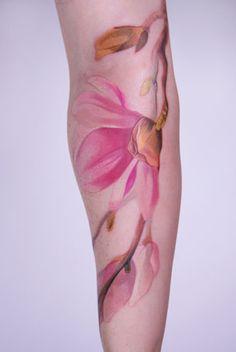 Watercolour tattoo. Beautiful detail. Interesting placement