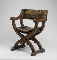 "Example of a Roman ""curule"" chair. ""It descends from the sella curulis, or curule chair, an ancient Roman folding seat used by consuls and high officials. In its elegant medieval interpretation, the throne-like chair—by then called a faldistorium—continued to symbolize secular power, and as the customary seat of the higher clergy, it also came to express the authority of the church"". Metropolitan Museum of Art, New York."