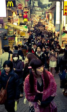 2002 Harajuku, Shibuya, Tokyo, Japan.  Shopping, dim sum. people watching.  Crazy busy.  Wealthy woman wear full kimono, young ladies dress like dolls, coffee boss (hot and cold), Hello Kitty and condoms.