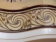 A close-up of an ornamental railing fabricated by Teddy's Custom Metalworks, inc.  http://teddyscustommetalworksinc.com/index.html