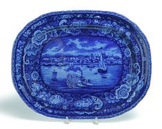 """Garth's Sale 1114 Lot 441. May 17 2014. HISTORICAL BLUE STAFFORDSHIRE PLATTER.  England, 2nd quarter-19th century. Dark blue transfer with floral border. Detroit from the """"American Cities Series"""". This one features the waterfront with a double paddle steamboat & was designed after View of Detroit painted by William James Bennet (New York, 1787-1844). 20.5""""l.   Estimate $ 3K-5K."""